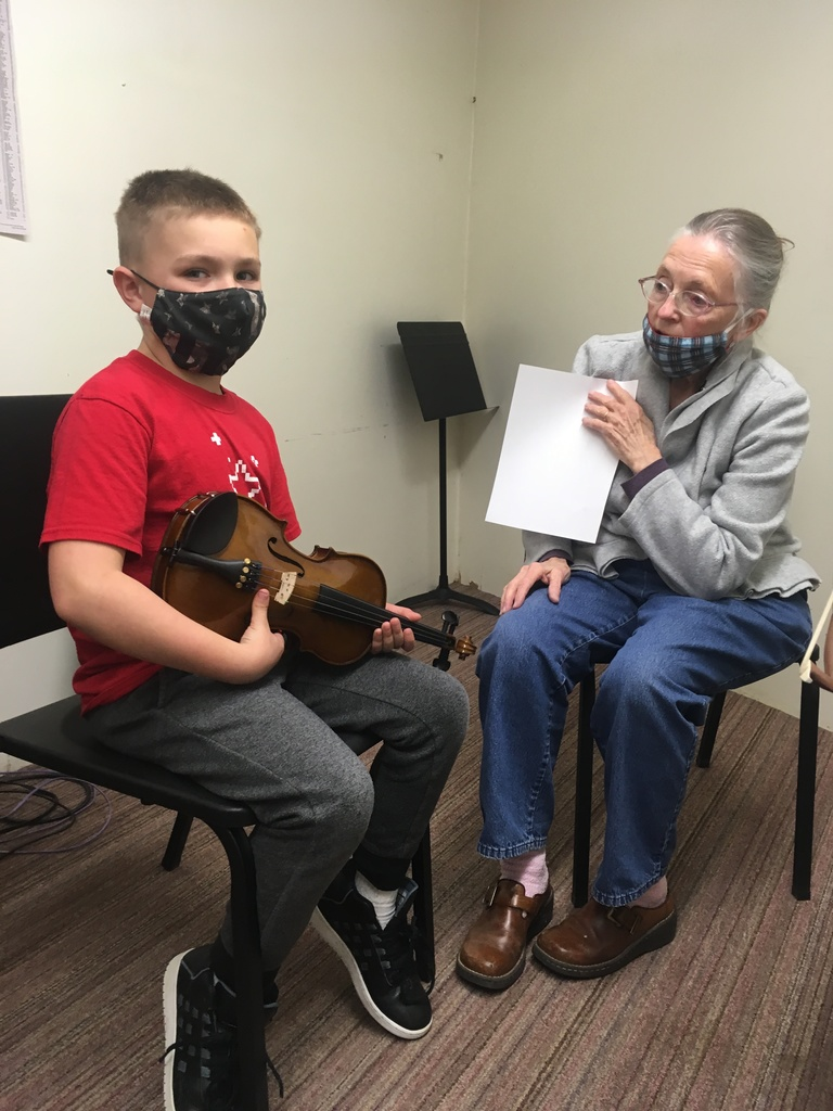 Student learning violin